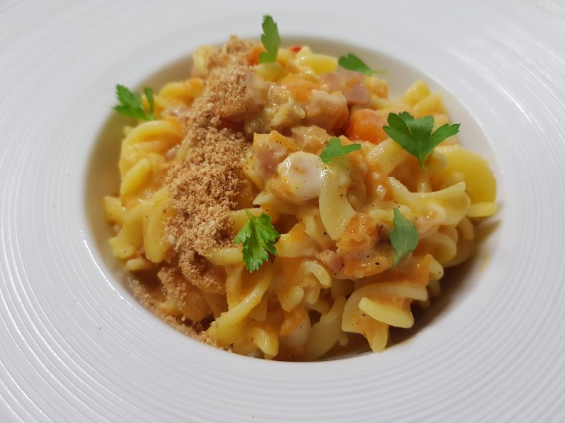 Fusilli with pumpkin cream, black pork bacon and pecorino