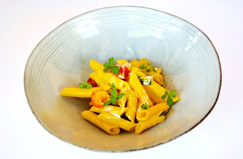 Penne with vegetables, safron and burrata